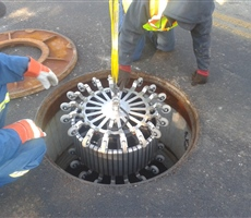 Lowering a Chimera tool through manhole