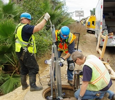 Field Crew lowering centralizer arms for Bracelet Probe inspection in part of a raw water pipeline