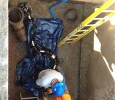 "Crew extracting 10"" See Snake tool from well water pipeline"